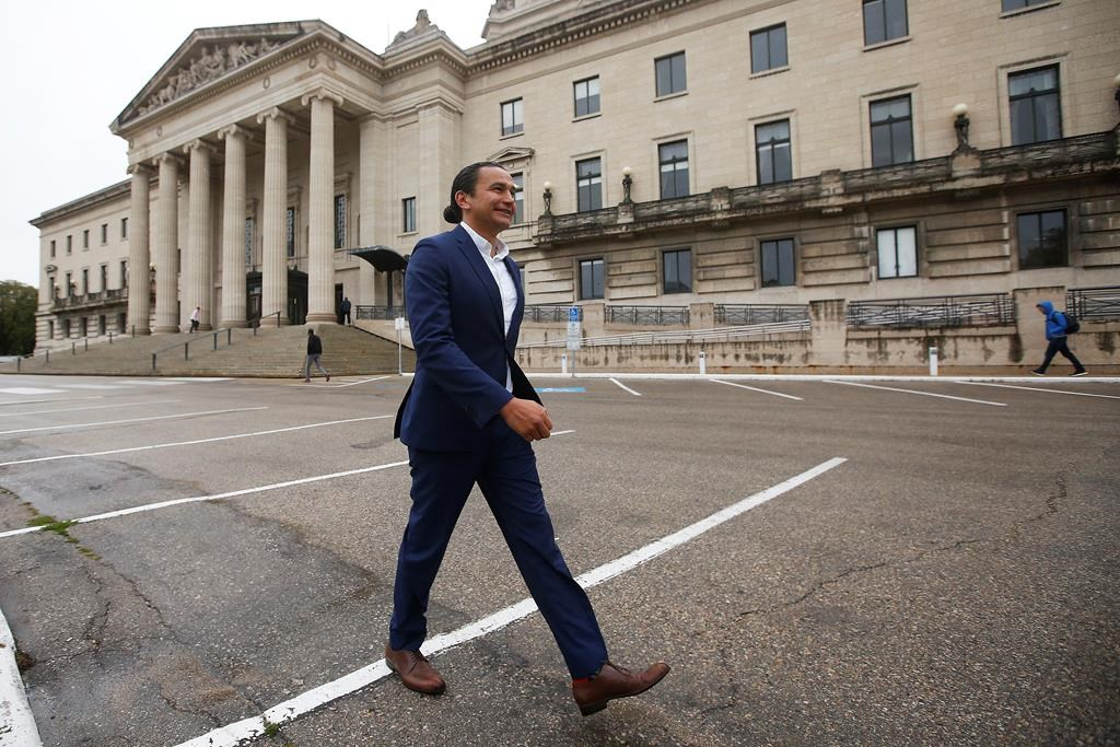 Manitoba NDP leader Wab Kinew leaves after speaking to media on election day outside the Manitoba Legislature in Winnipeg, Tuesday, September 10, 2019. THE CANADIAN PRESS/John Woods.