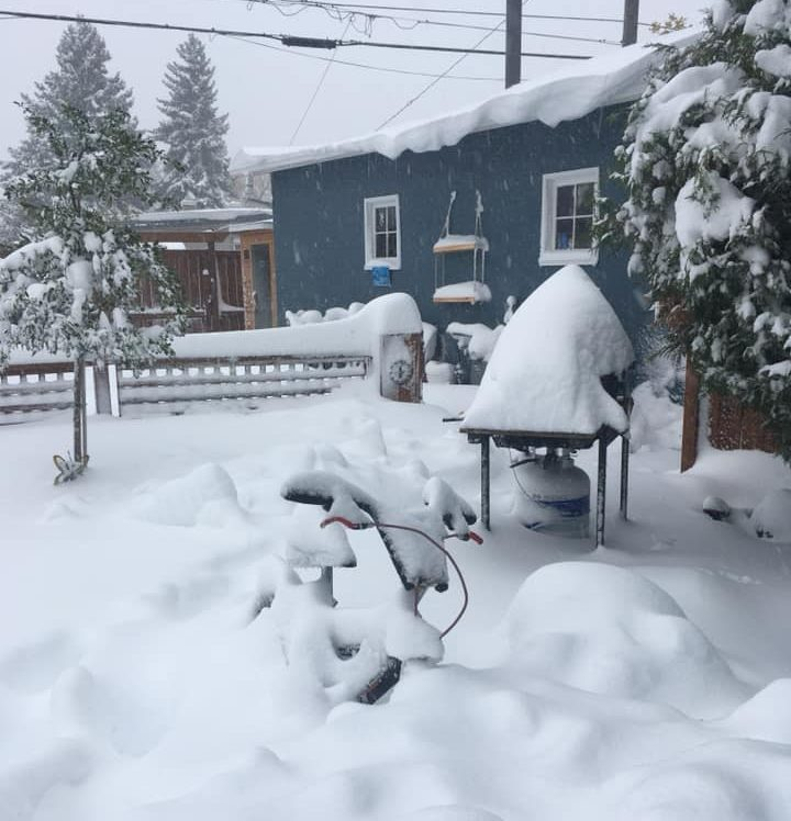 Snow piled high in a Lethbridge yard on Sunday, Sept. 29, 2019.