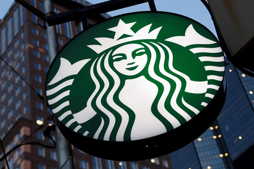 FILE - This June 26, 2019 file photo shows a Starbucks sign outside a Starbucks coffee shop in downtown Pittsburgh.(AP Photo/Gene J. Puskar, File).