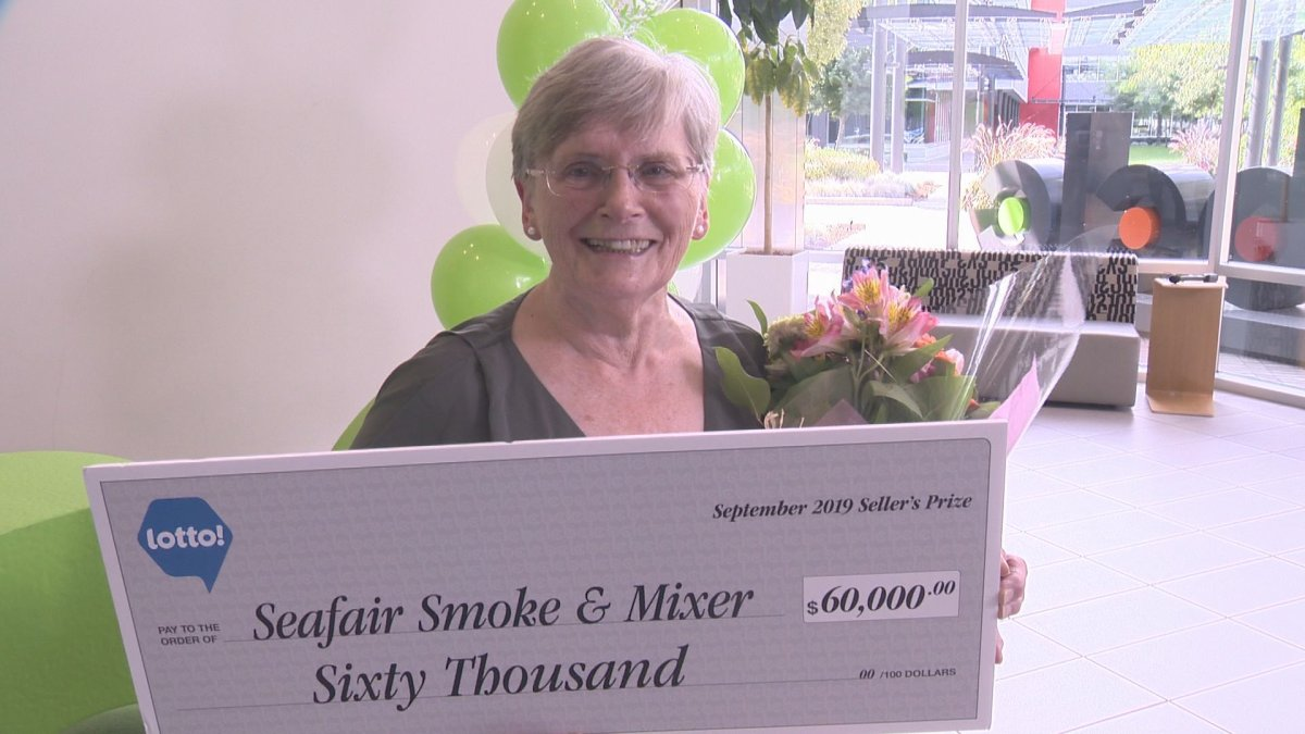 Verna Holmes celebrates her prize for selling the winning ticket in August's $60 million lotto jackpot.
