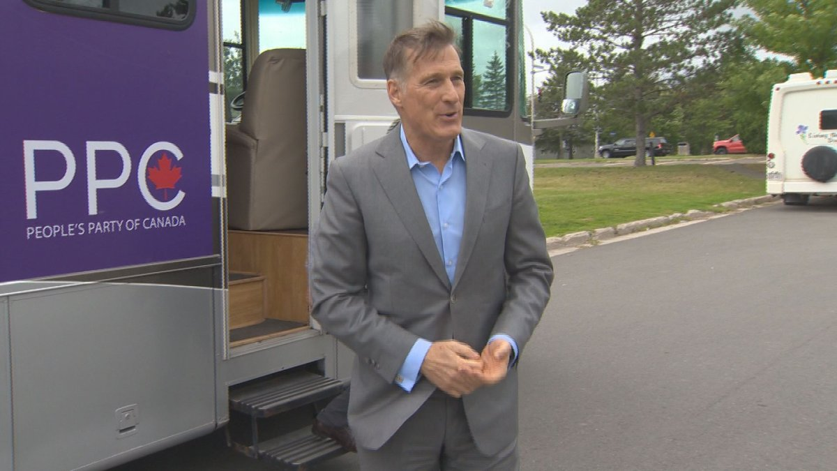 People's Party of Canada leader Maxime Bernier greets reporters in Oromocto, NB. Sept. 17, 2019.