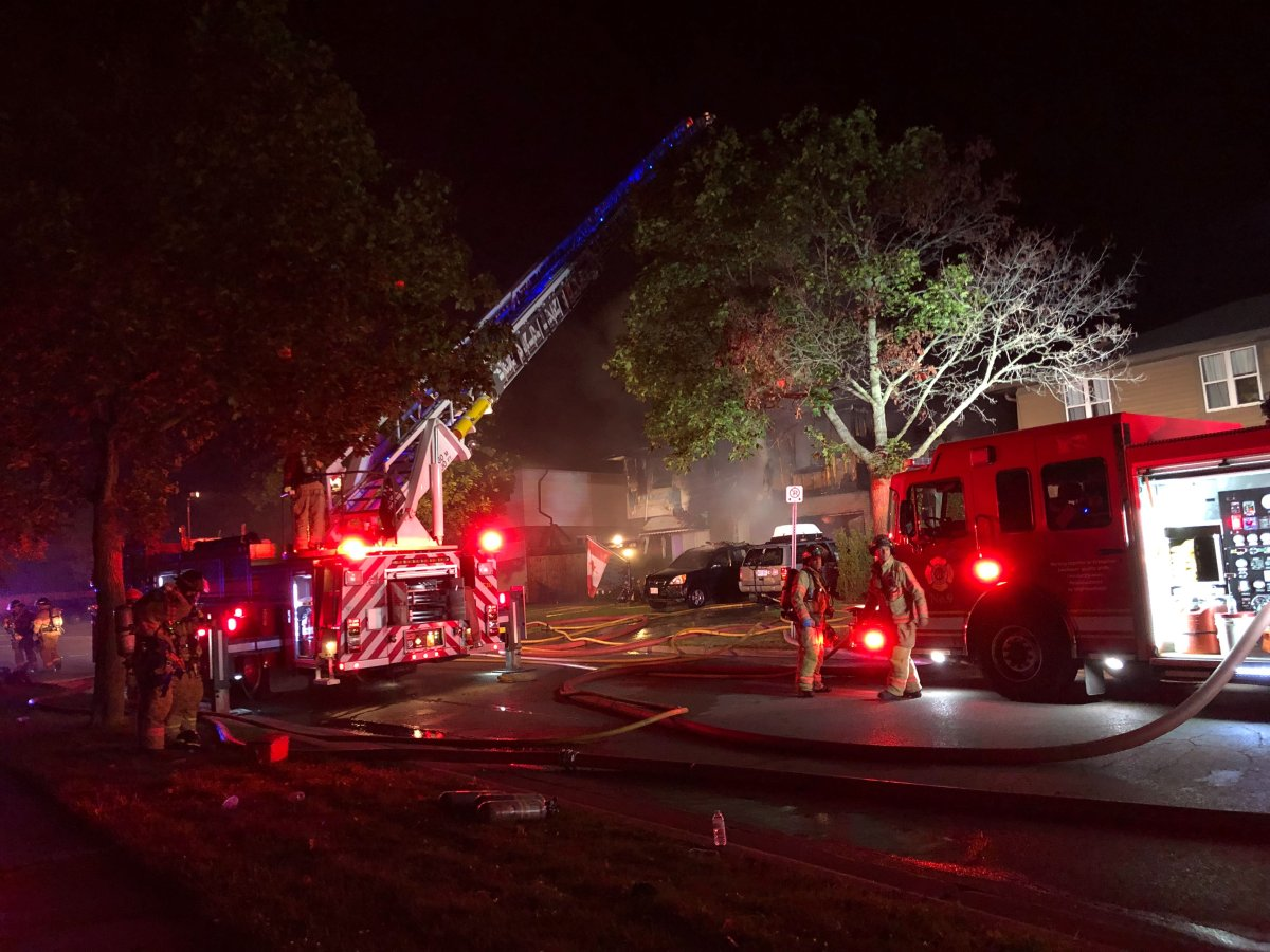 Fire crews battle a blaze along Millbank Drive in the early morning hours of Sept. 10, 2019.