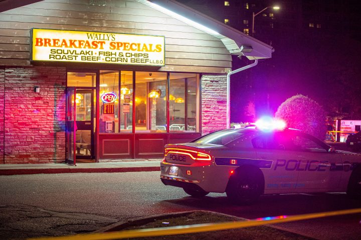 Police at the scene of a fatal shooting outside of Wally's Family Restaurant in Mississauga early on Sept. 1.