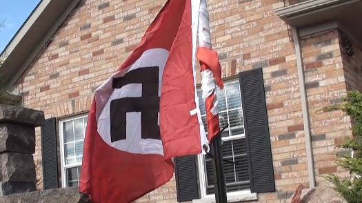 Cobourg police are investigating after a flag with a hate symbol was put up at west-end home.