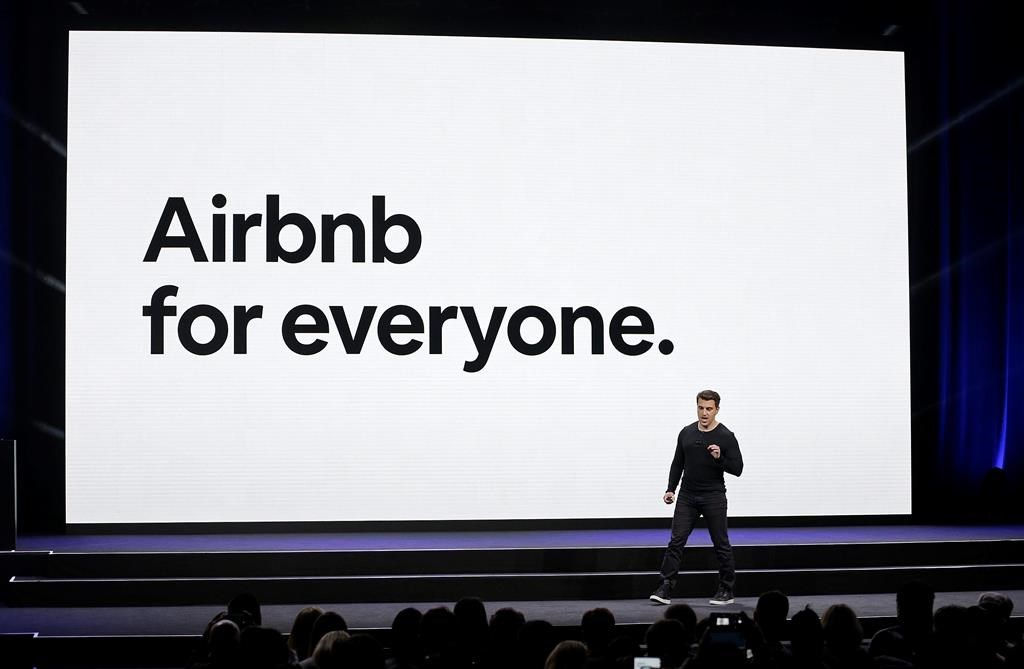 FILE - In this Feb. 22, 2018, file photo, Airbnb co-founder and CEO Brian Chesky speaks during an event in San Francisco.
