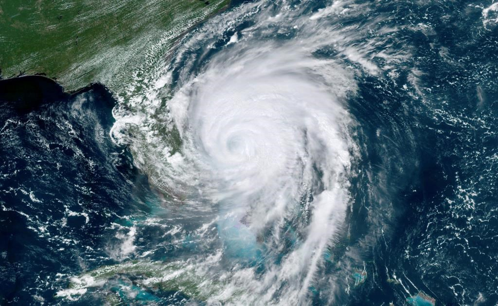 This satellite image taken Tuesday, Sept. 3, 2019, shows hurricane Dorian moving off the east coast of Florida in the Atlantic Ocean.