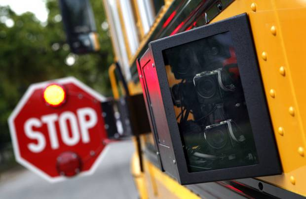 """Four more school buses in Ottawa have been kitted out with """"stop-arm cameras"""" this week as children head back to school for the fall, Ottawa police say."""