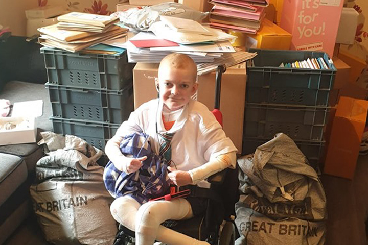 Rhys Williams, 13, is shown with piles of letters he received to wish him a happy birthday.