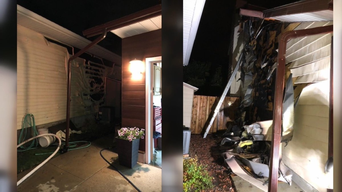 A neighbour used a garden hose prior to Saskatoon firefighters arriving to prevent a garage fire from spreading on Sept. 8, 2019.