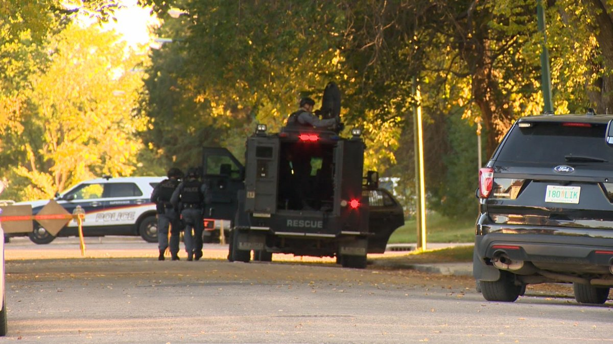Saskatoon police said a man was spotted in a residence armed with a firearm and that he barricaded himself inside.