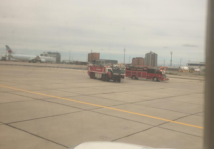 Emergency crews responded to the plane, but no injuries have been reported.