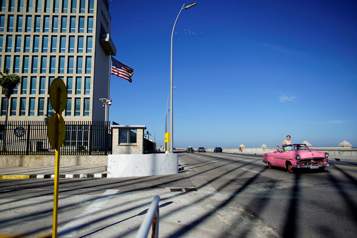 Tourists in a vintage car pass by the U.S. Embassy in Havana, Cuba, November 1, 2018.