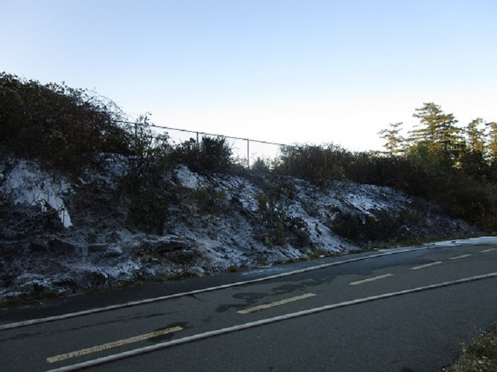 Police said what appears to be snow in this photo is ash and residue left over after crews extinguished a suspicious brush fire near along the Galloping Goose trail.