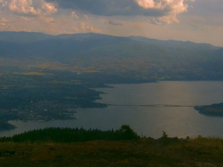 A view of Okanagan Lake and Kelowna on Saturday, Sept. 7, 2019. A meteorologist says B.C.'s source for weather is usually the Pacific, and temperatures there are above average, which will likely result in warmer than average temperatures for the next three months.