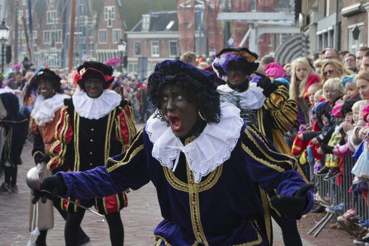 "A ""Zwarte Piet"" or ""Black Pete"", jokes with children after arriving with Sinterklaas, or Saint Nicholas, by steamboat in Hoorn, north-western Netherlands, Saturday Nov. 16, 2013."