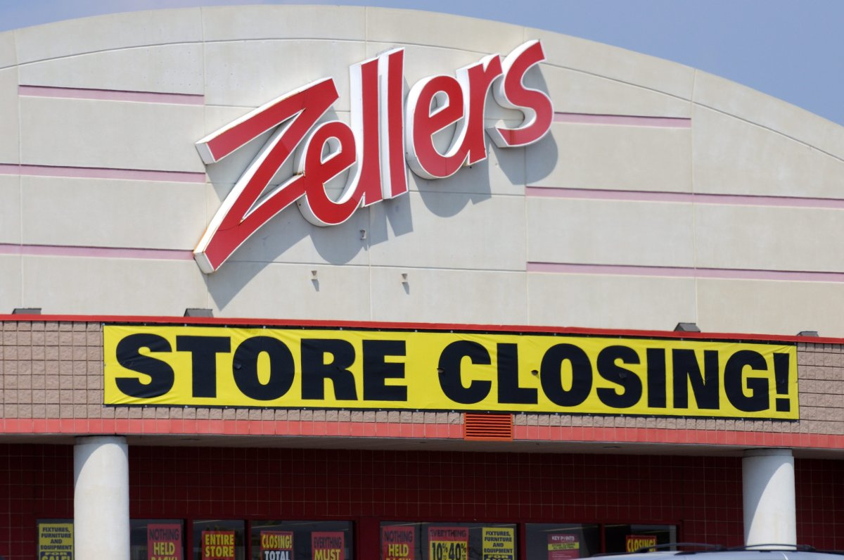 """A Zellers store with a """"store closing"""" sign."""