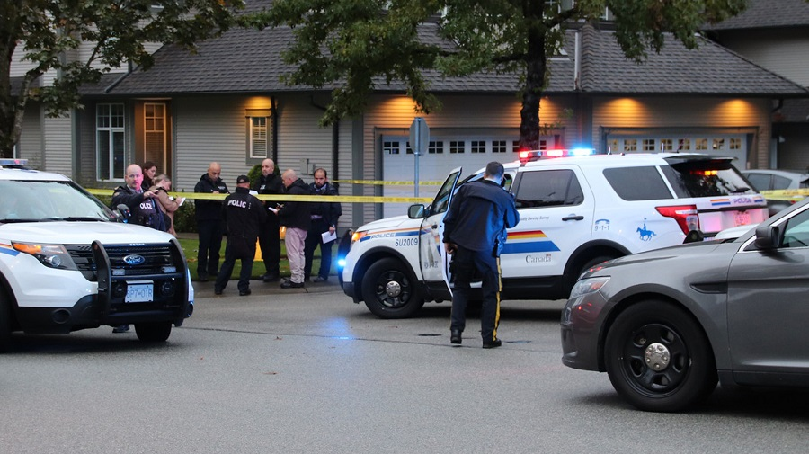 Surrey RCMP and homicide investigators outside a Newton home on Oct. 4, 2019, where a woman was found dead and a man was arrested.
