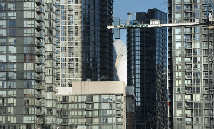 Toronto police have arrested a man after he allegedly climbed onto a crane in Yorkville with a parachute.