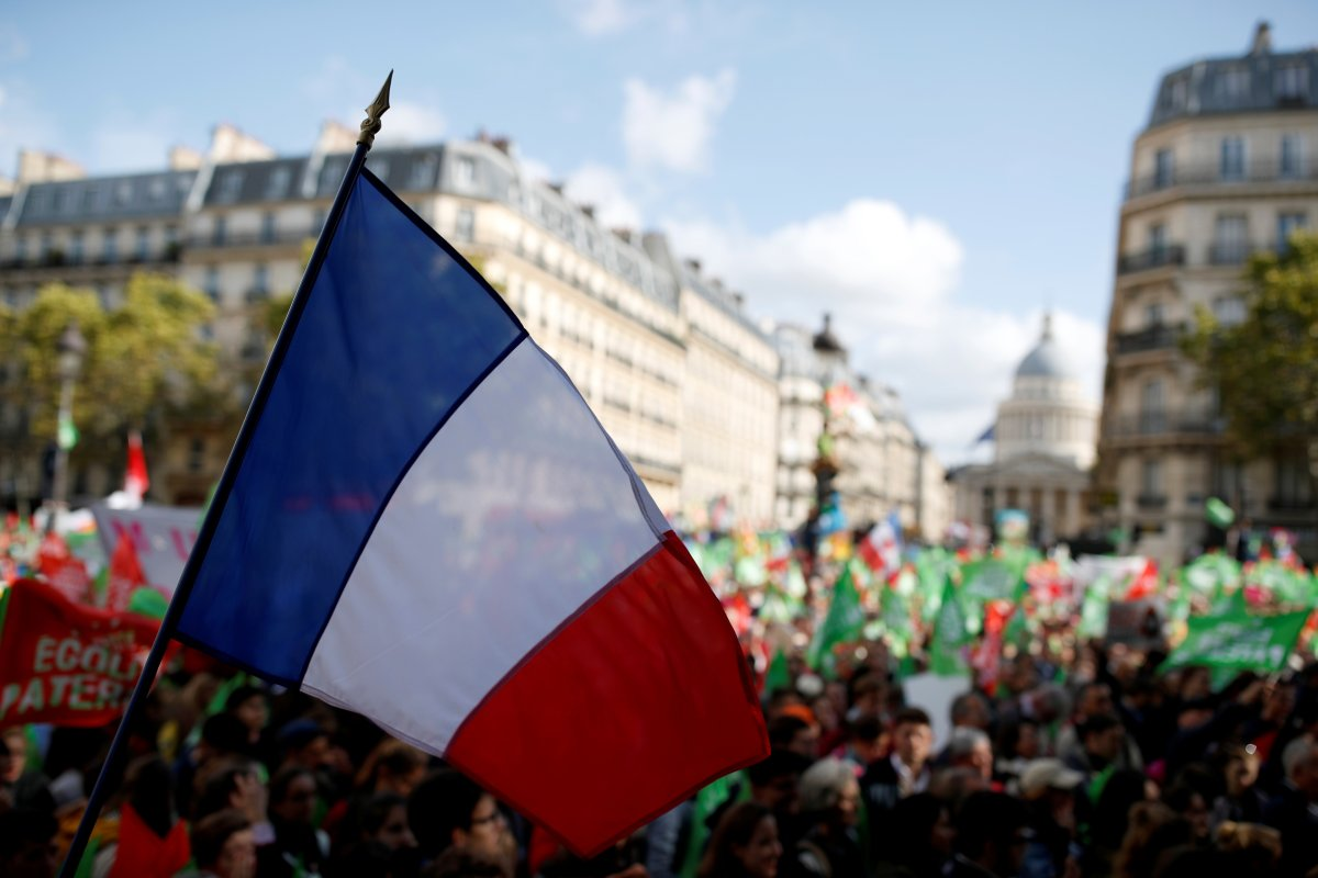 A French flag is pictured as protesters demonstrate against a reform bill that will widen access to medically assisted procreation to lesbian couples and single women, in Paris, France, October 6, 2019.