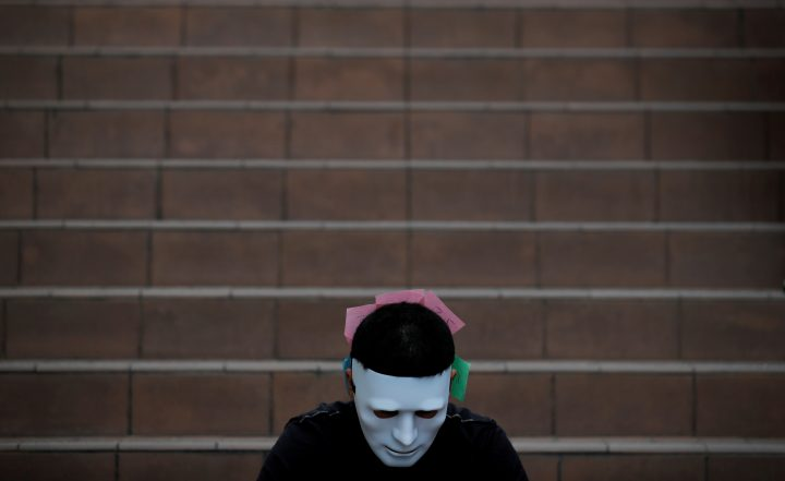 A man wearing a mask attends an anti-government protest in Hong Kong, China, October 18, 2019.