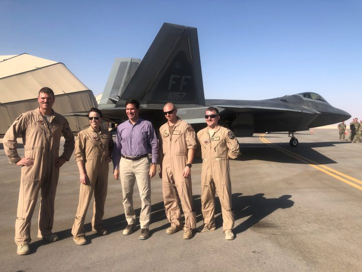 U.S. Defense Mark Esper speaks with U.S. troops in front of an F-22 fighter jet deployed to Prince Sultan Air Base in Saudi Arabia Oct. 22, 2019.