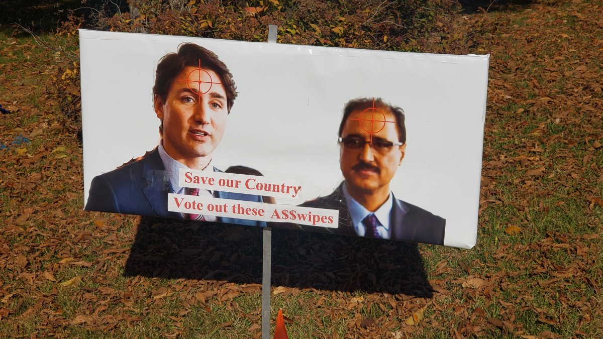 A sign on a lawn in southeast Edmonton showing Liberal leader Justin Trudeau and Edmonton Mill Woods candidate Amarjeet Sohi with crosshair targets on the foreheads. Thursday, October 3, 2019.