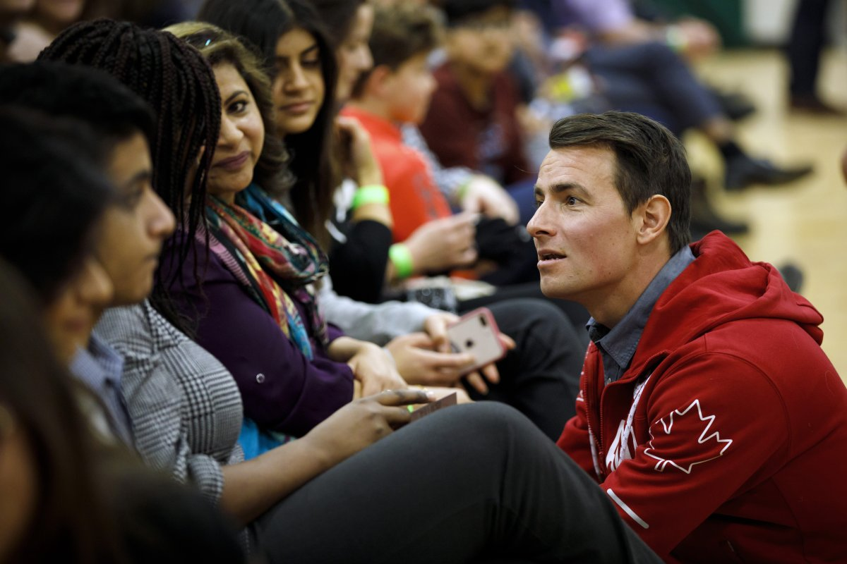 Adam van Koeverden, the Liberal candidate for southern Ontario riding of Milton greets people prior to Prime Minister Justin Trudeau's town hall event in Milton, Ontario on Thursday, Jan. 31, 2019.