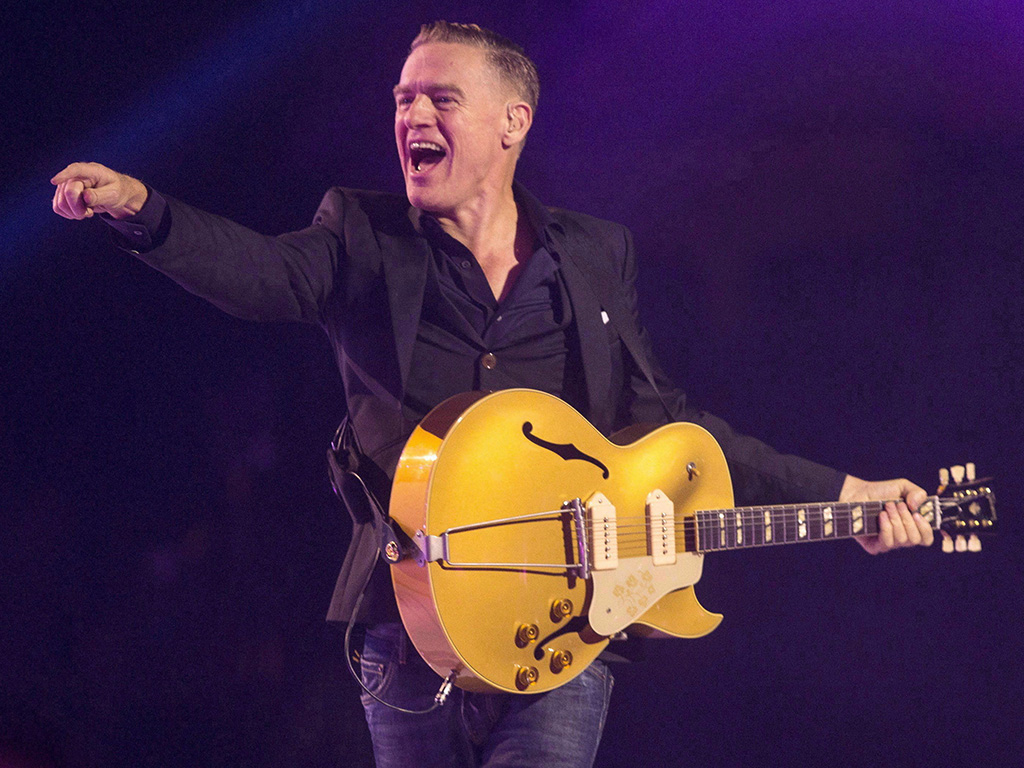 Bryan Adams performs during the Invictus Games closing ceremony in Toronto on Sept. 30, 2017. The Progressive Conservatives have turned to Adams' longtime hitmaker Jim Vallance to pen their campaign song.