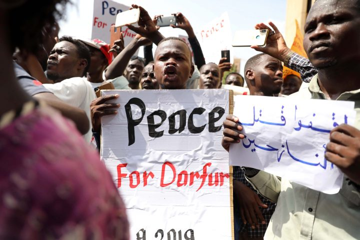 Sudanese protesters hold a banners against war in Darfur region, during a protest calling for the extradition of ousted president Omar Bashir to the International Criminal Court (ICC) in front of the Ministry of Justice in Khartoum, Sudan, 23 September 2019.