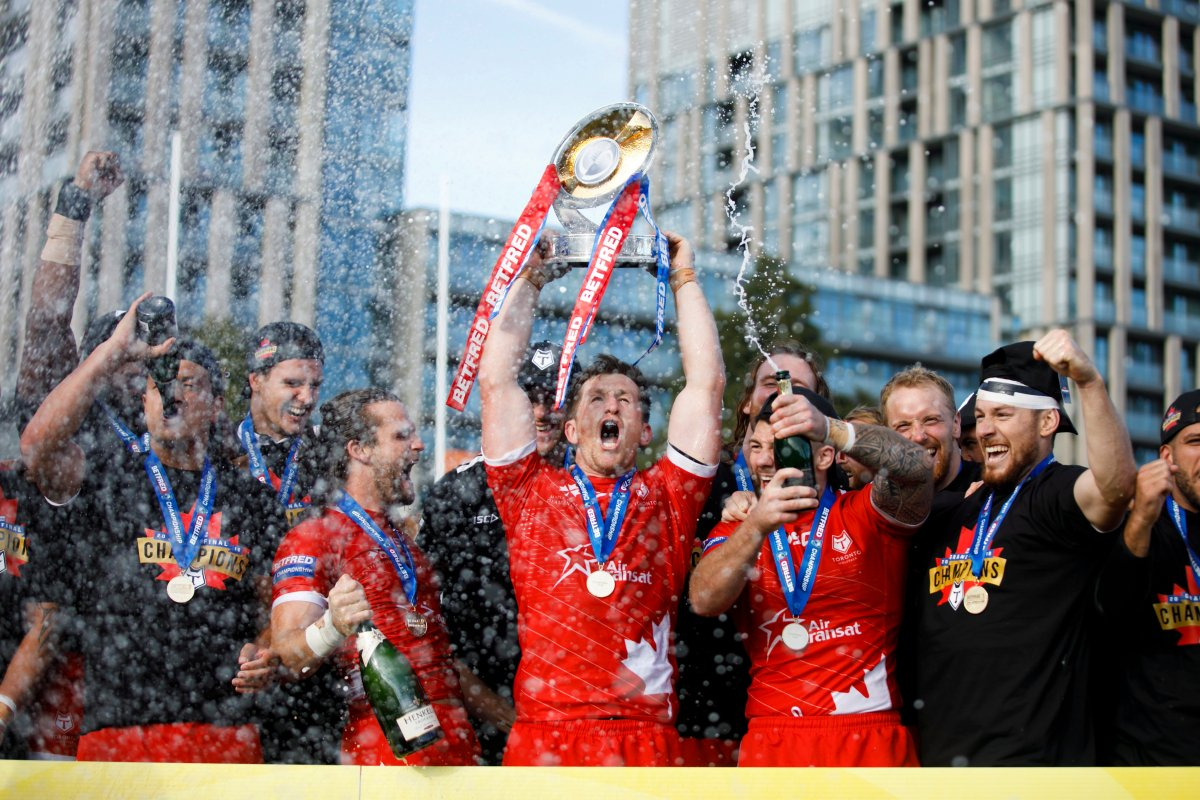 Toronto Wolfpack captain Josh McCrone raises the Betfred Championship Trophy alongside teammates after defeating the Featherstone Rovers in the Million Pound Game in Betfred Championship rugby league action in Toronto, Saturday, Oct. 5, 2019.