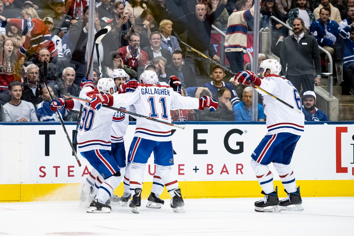 Montreal Canadiens celebrate a goal during third period NHL hockey action against the Toronto Maple Leafs, in Toronto, Saturday, Oct., 5, 2019.