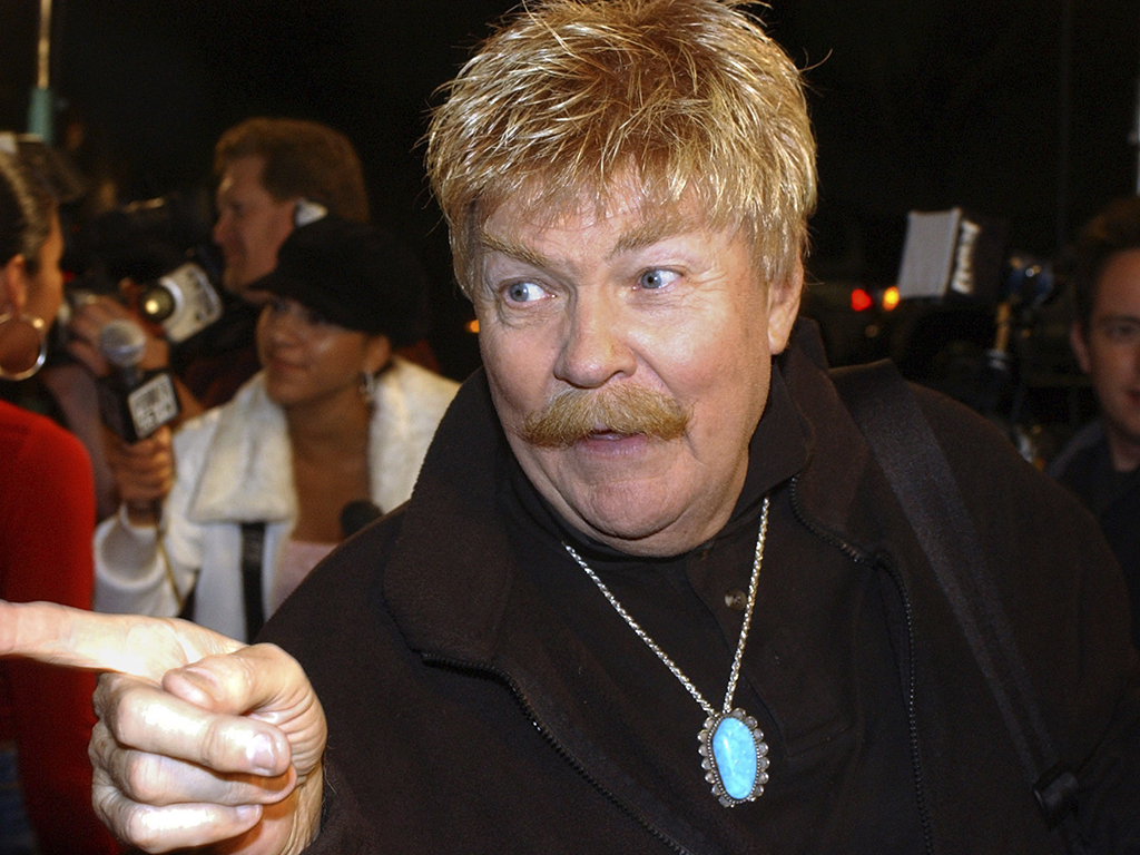 In this Monday, Oct. 21, 2002, file photo, comedian Rip Taylor talks with reporters before a film premiere, in the Hollywood section of Los Angeles. Taylor, the mustached comedian with a fondness for confetti-throwing who became a television game show mainstay in the 1970s, died Sunday, Oct. 6, 2019. He was 84.