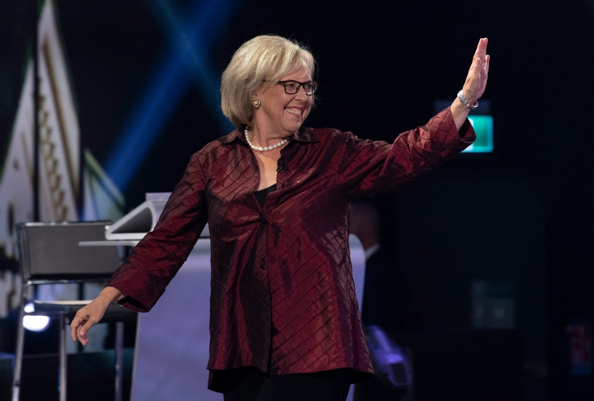 Green Party leader Elizabeth May waves as she walks on stage for the Federal leaders French language debate in Gatineau, Que. on Thursday, October 10, 2019.