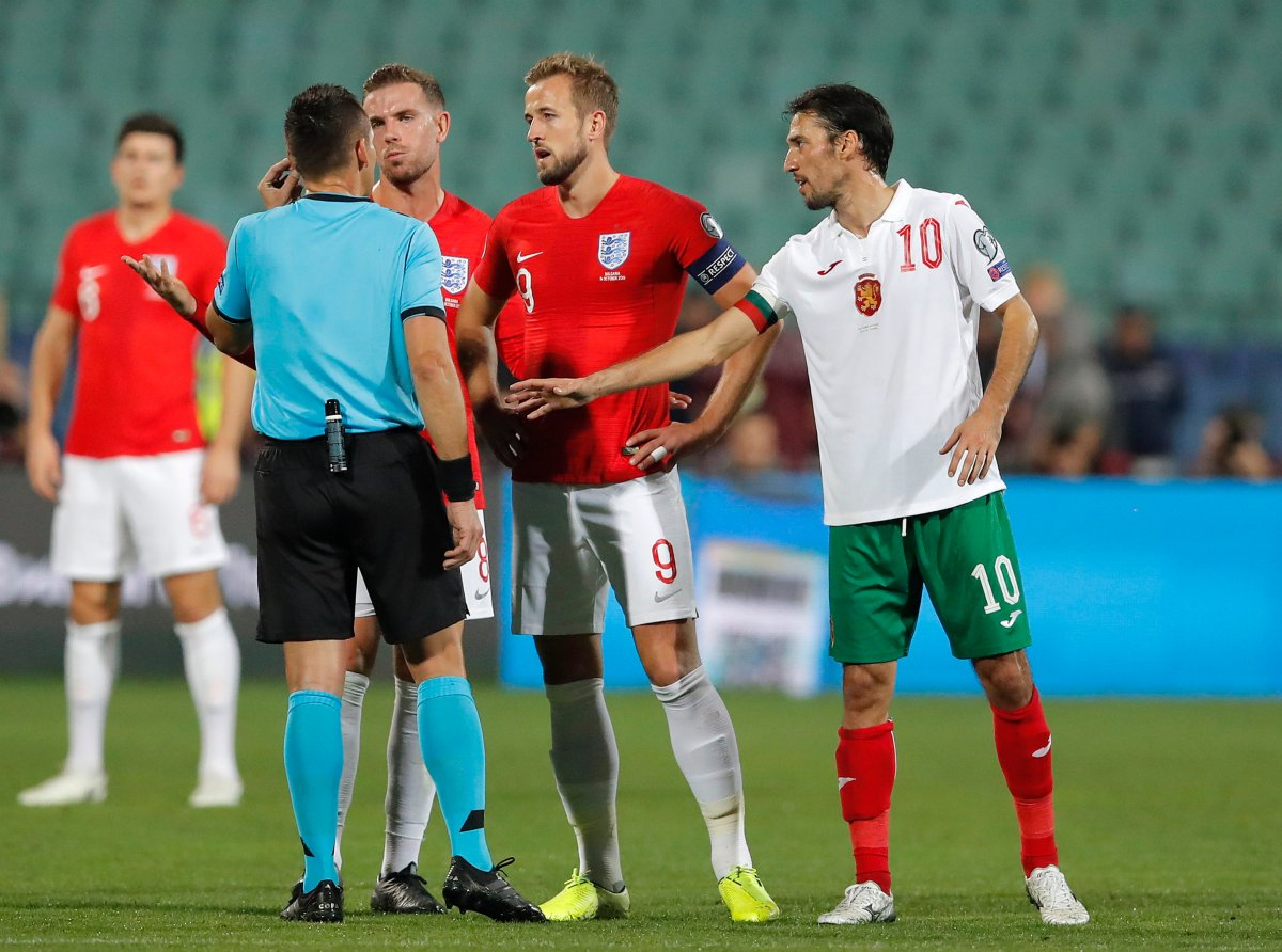 England's Harry Kane, center, and Jordan Henderson speak with Referee Ivan Bebek during the Euro 2020 group A qualifying soccer match between Bulgaria and England, at the Vasil Levski national stadium, in Sofia, Bulgaria, Monday, Oct. 14, 2019.