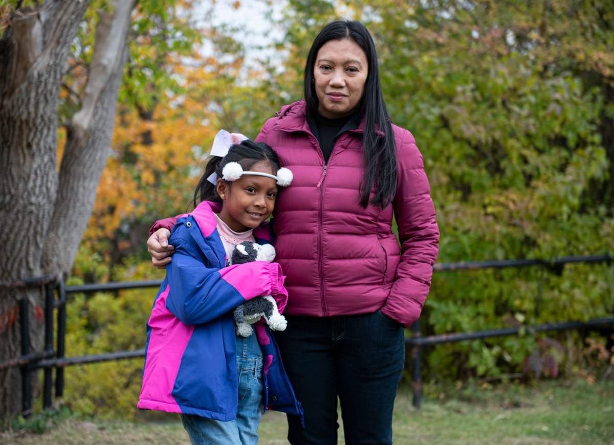 "Vanessa Mae Rodel and her daughter Keana Kellapatha, 7, are seen after a press conference on the status of the ""Snowden Refugees"", Keana's father and siblings that remain in Hong Kong, in Ottawa, on Wednesday, Oct. 16, 2019."