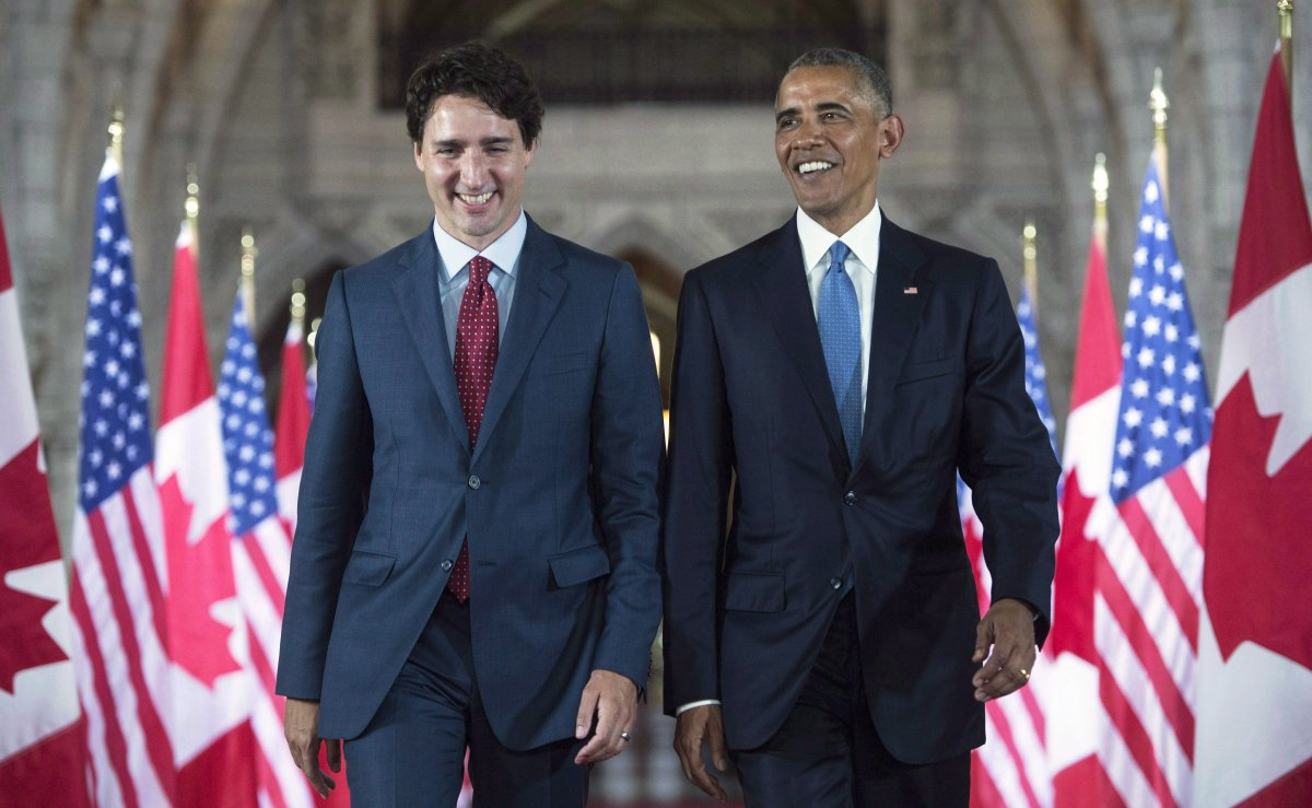U.S. President Barack Obama and Prime Minister Justin Trudeau walk down the Hall of Honour on Parliament Hill, in Ottawa, June 29, 2016.