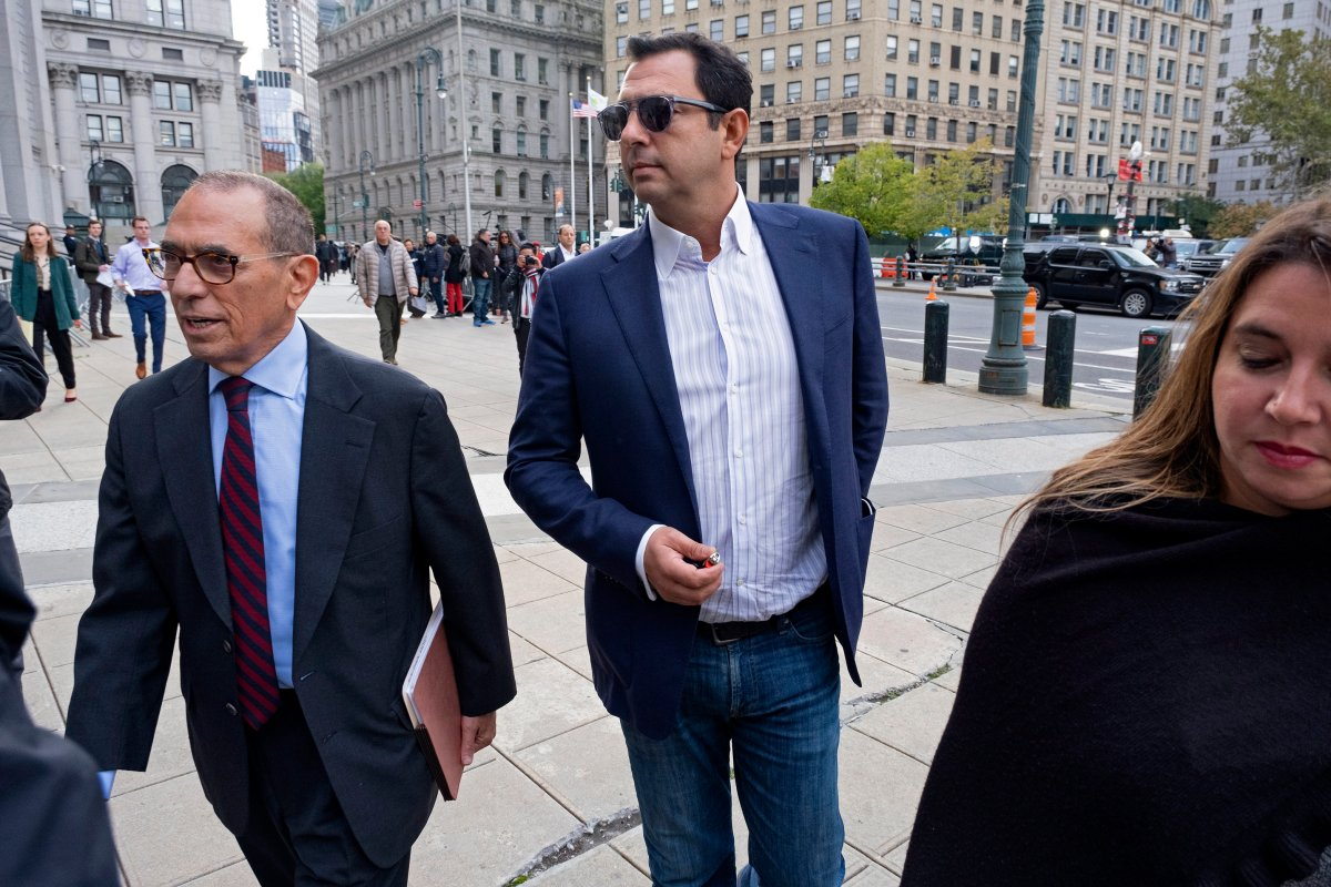 Andrey Kukushkin, center, leaves federal court, Thursday, Oct. 17, 2019, in New York. Kukushkin and David Correia pleaded not guilty Thursday to conspiring with associates of Rudy Giuliani to make illegal campaign contributions.