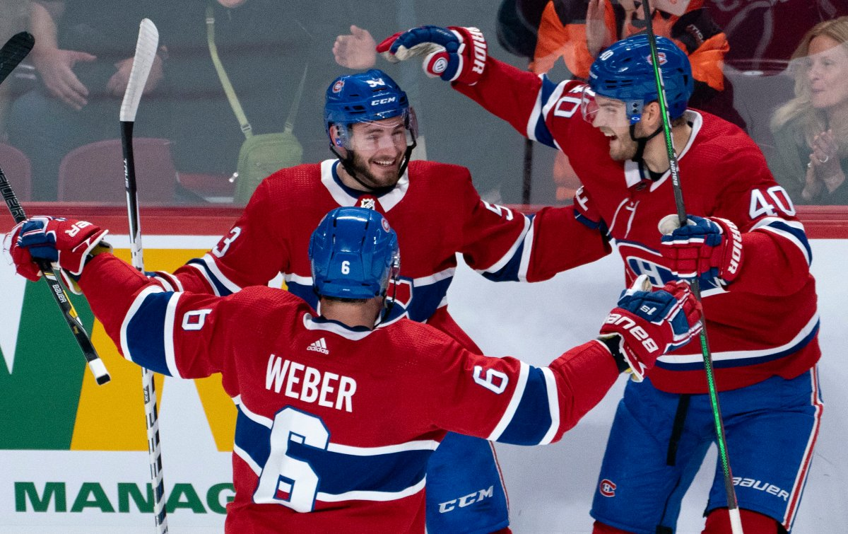 Montreal Canadiens' Victor Mete celebrates his goal against the Minnesota Wild with teammates Shea Weber, left, and Joel Armia, right, during first period NHL hockey action in Montreal on Thursday, October 17, 2019.