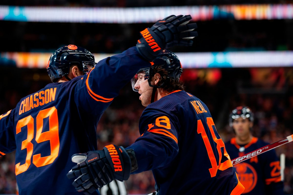 Edmonton Oilers left wing James Neal (18) celebrates his goal against the Detroit Red Wings with teammate Alex Chiasson (39) during the second period in Edmonton on Friday, Oct. 18, 2019. THE CANADIAN PRESS/Codie McLachlan.