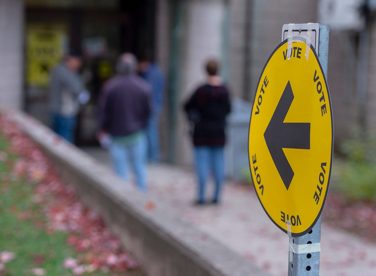 Voters head to cast their ballot in Canada's federal election.