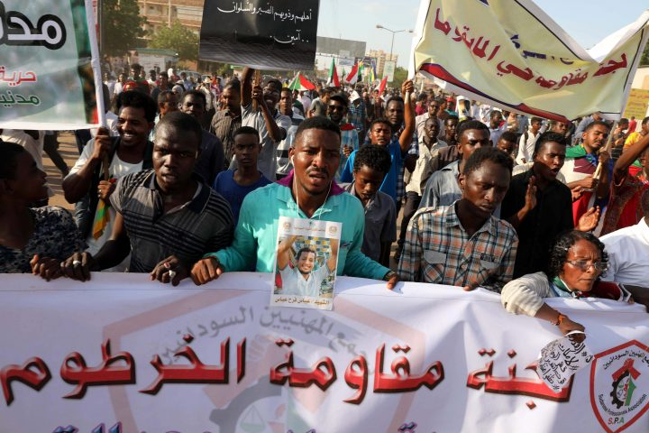 Sudanese protesters hold a banner with Arabic inscription reading 'Khartoum resistance committee' during a march in Khartoum, Sudan, 21 October 2019.