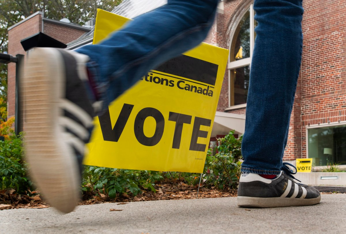 A man walks to a polling station in Toronto, on October 21 2019 to vote in the country's 43rd federal election.