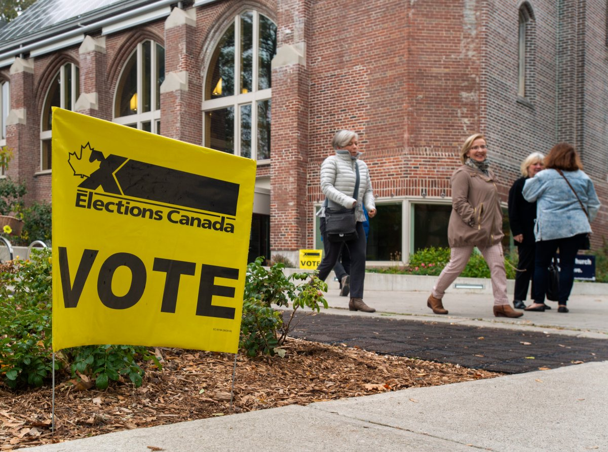 People leave a polling station in Toronto, Canada, 21 October 2019. Canadians are voting in the country's 43rd federal election this day.  EPA/WARREN TODA.