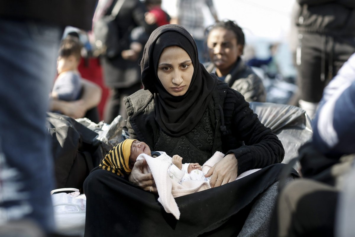 A Syrian refugee mother holds her newborn baby after disembarking from the ferry 'Paros Jet' upon their arrival from Samos Island at the port of Elefsina near Athens, Greece, 22 October 2019.