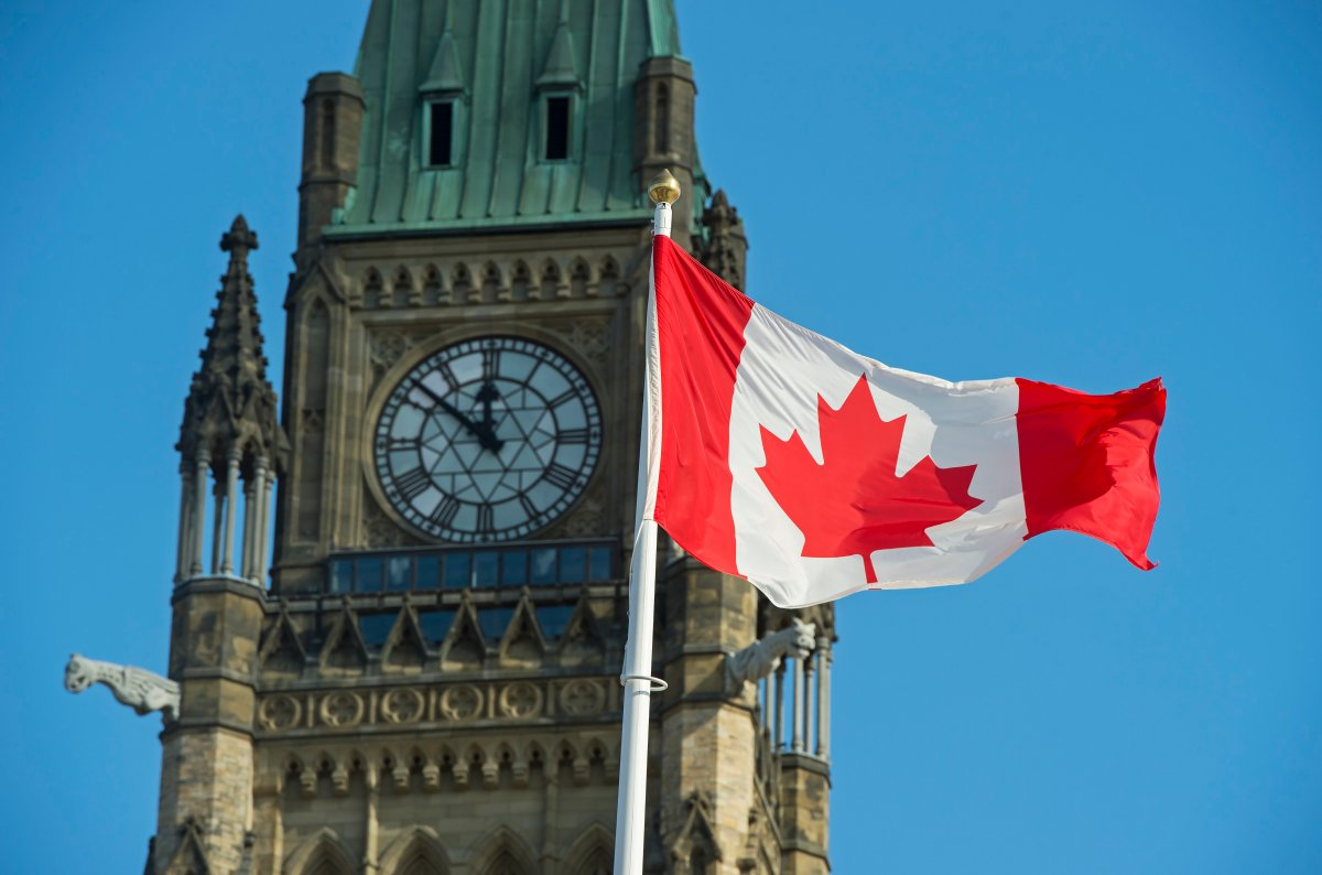 A Canadian flag flies near the Peace Tower on Parliament Hill in Ottawa on Wednesday, Oct. 23, 2019.
