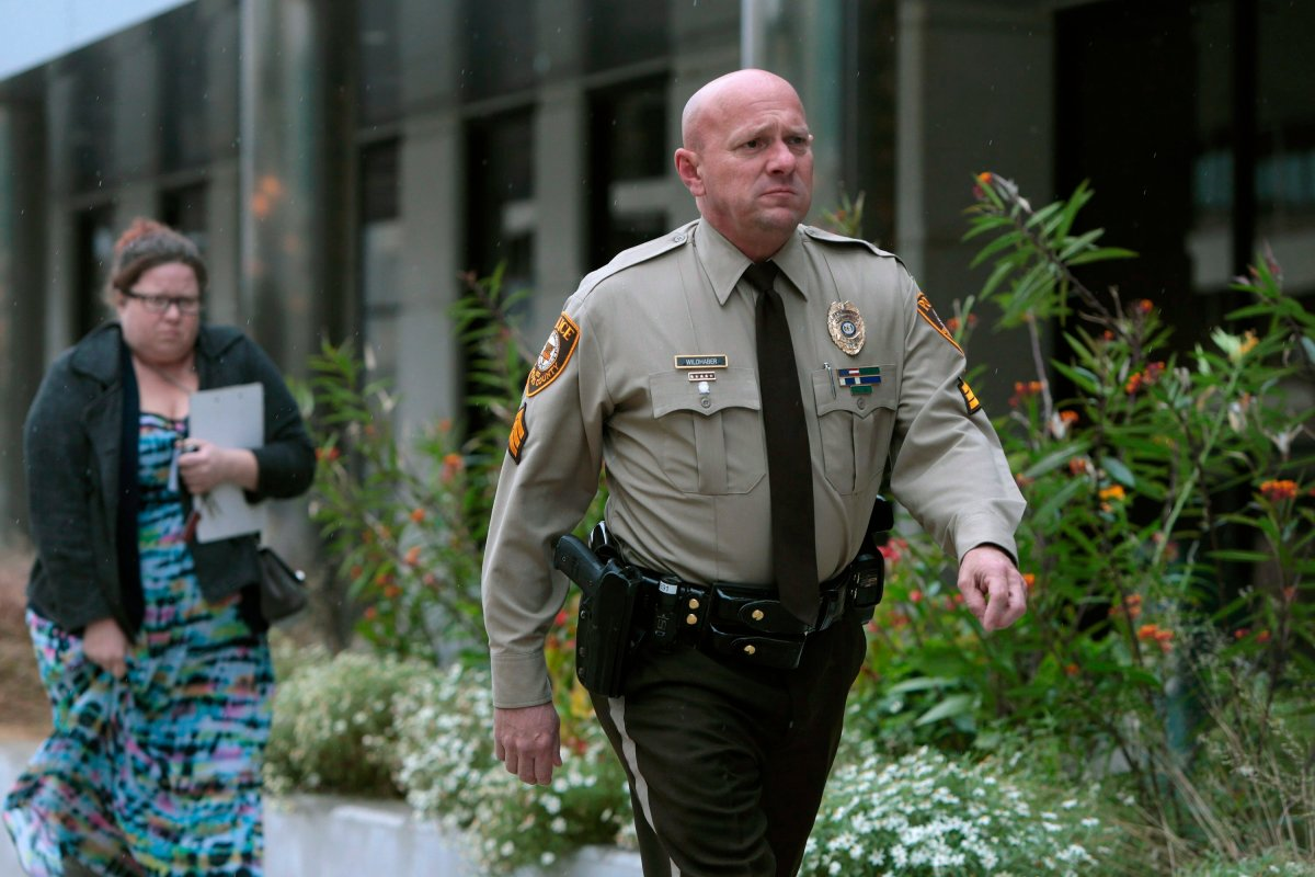 In this Oct. 24, 2019 file photo, St. Louis County police Sgt. Keith Wildhaber returns from lunch break to the St. Louis County courthouse on the third day of his discrimination case against the county in Clayton, Mo.
