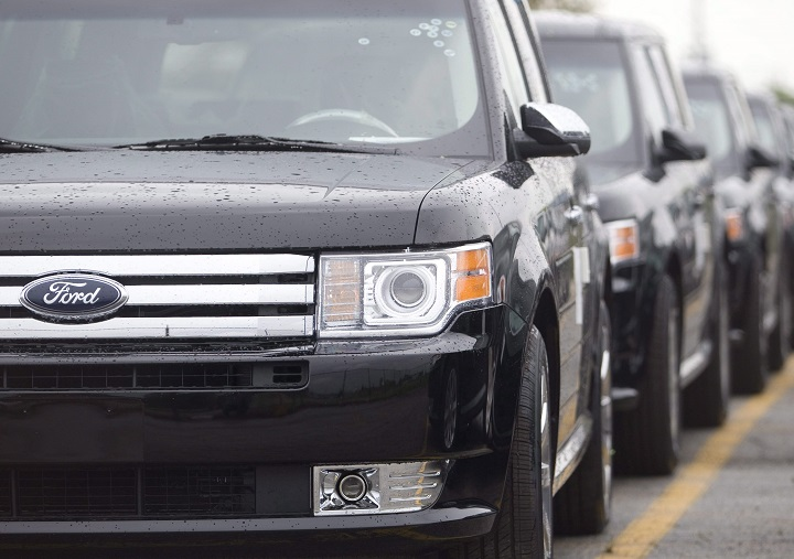 Ford Flex crossover vehicles sit in parking lots outside the production facility in Oakville, Ont., Tuesday, June 3, 2008. Ford Motor Co.'s largest Canadian manufacturing operation will eliminate 450 jobs by early 2020 as the company discontinues two of the models made at the Oakville, Ont., complex.