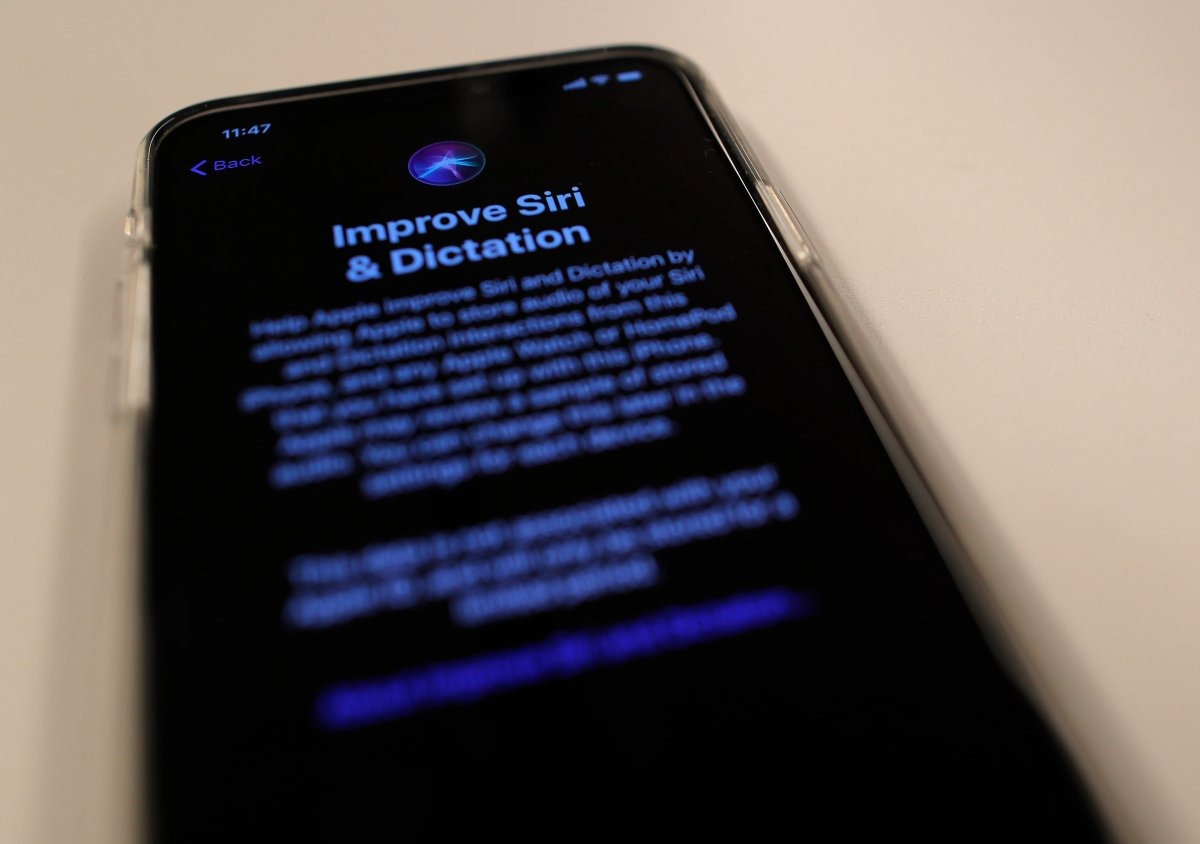 A screen displays a notice when installing the update, iOS 13.2 on an iPhone on Tuesday, Oct. 29, 2019, in New York.