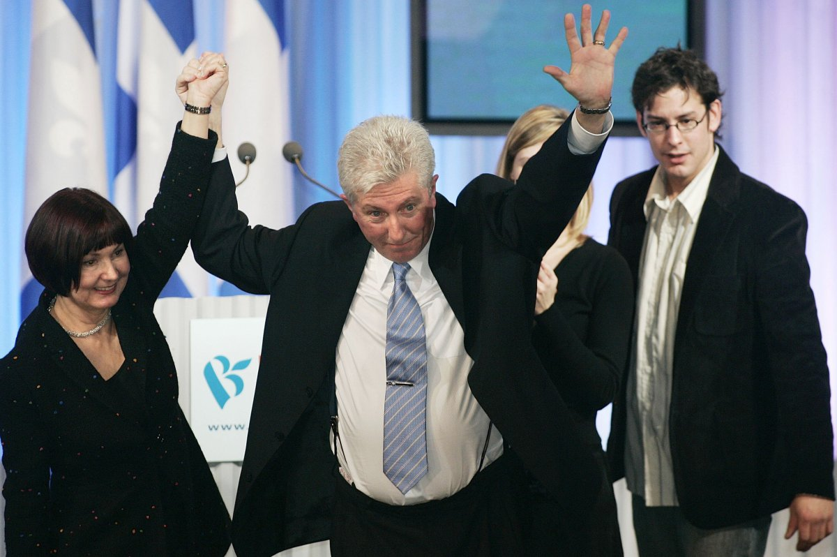 In 2006, former Bloc Québécois Leader Gilles Duceppe joins hands with his wife Yolande Brunelle at the end of his election speech. Duceppe's son Alexis and daughter Amelie stand behind.