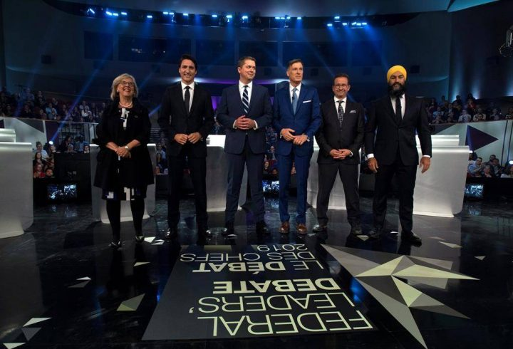Green Party Leader Elizabeth May, Liberal Leader Justin Trudeau, Conservative Leader Andrew Scheer, People's Party of Canada Leader Maxime Bernier, Bloc Québécois Leader Yves-François Blanchet and NDP Leader Jagmeet Singh pose for a photograph before the federal leaders' debate in Gatineau, Que., on Monday, Oct. 7, 2019.
